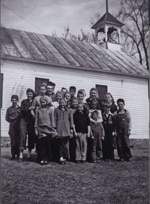 This picture was taken in 1946 after World War II. Back Row: Our teacher Miss Annonson's brother with the uniform on, he came and visited her at Long Lake School, Gordon Whitney, Glen Johnson, Donald Ancke, hidden behind Beverly Rydeen is Leighton Natt, Dorothy Whitney and Kathryn Johnson. Middle Row: Raymond Krech, Karen Berglund, Darlene Whitney, Irene Ancke, Shirley Rydeen, Jeanette Johnson, Beverly Rydeen, Darlene Krech, David Klinefelter and Ai Cronk. First Row: Yvonne Carlson, Sharon Natt, Karen Bengston and Roy Johnson.