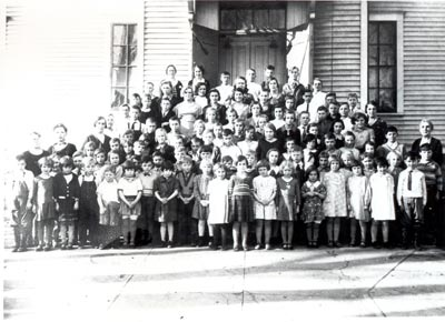 Oak Park School, District #14, 1932-33. Teachers in the photograph are, left to right, Alice Hooley, Helen Wohlers, Anna Johnson, and Carrie Cover.