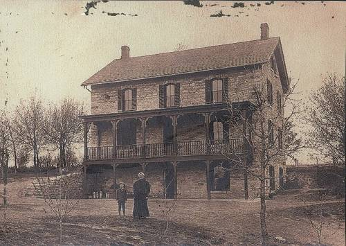 This house, originally owned by the Spangenberg family, was purchased by the Czikalla family in 1901. Standing in front of the house are Mrs. Frank Czikalla and her son Leonard Czikalla, Sr., ca. 1905. The Czikalla family owned the property until 2008.