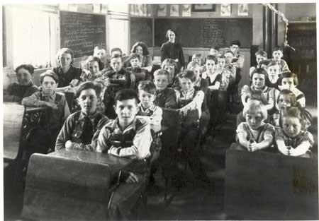 Interior of District #63 school, Miriane Jeans, Teacher.