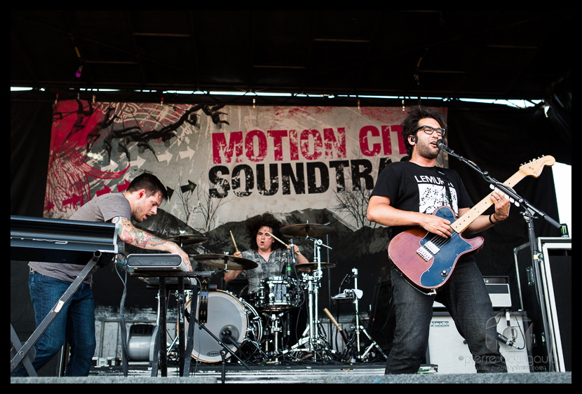Motion City Soundtrack rocking out on stage.